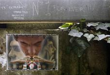 Handwritten notes left by fans are pictured on a fence at the site where Brazilian Formula One driver Ayrton Senna died at the race track in Imola April 22, 2014. REUTERS/Alessandro Garofalo