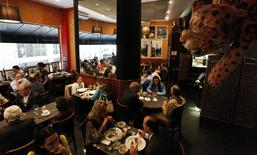 People lunch at Bar da Dona Onca restaurant in Sao Paulo April 24, 2014. REUTERS/Paulo Whitaker