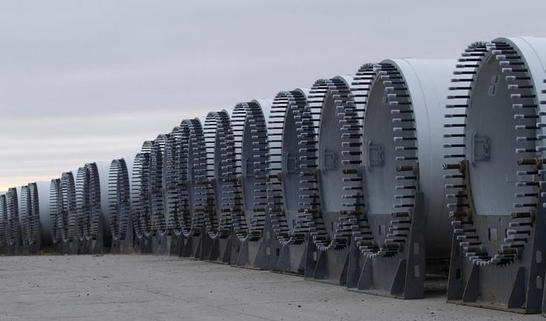 The base of several wind turbine blades are seen outside TPI Composites in Newton, Iowa December 22, 2011. REUTERS/Joshua Lott