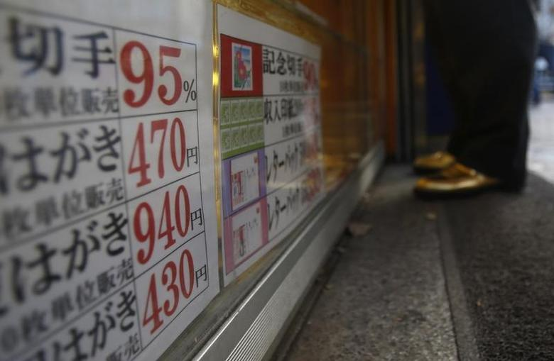 A man looks at the prices of tickets at a ticket shop in Tokyo November 29, 2013. REUTERS/Yuya Shino