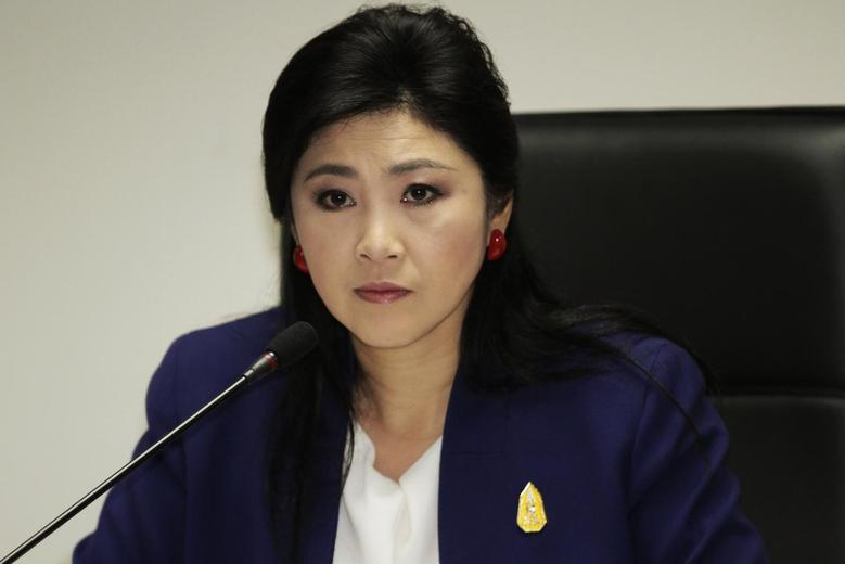 Prime Minister Yingluck Shinawatra attends her cabinet economic meeting at the office of the Permanent Secretary of Defense in Bangkok April 21, 2014. REUTERS/stringer