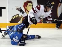 Latvia's Ralfs Freibergs (top) trips over Finland's Antti Pihlstrom during their 2013 IIHF Ice Hockey World Championship preliminary round match at the Hartwall Arena in Helsinki May 14, 2013. REUTERS/Grigory Dukor