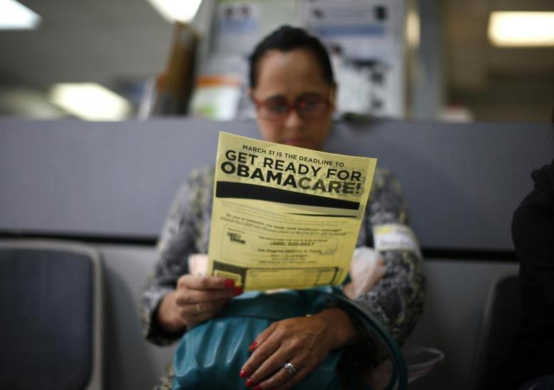 Arminda Murillo, 54, reads a leaflet at a health insurance enrollment event in Cudahy, California March 27, 2014. REUTERS/Lucy Nicholson