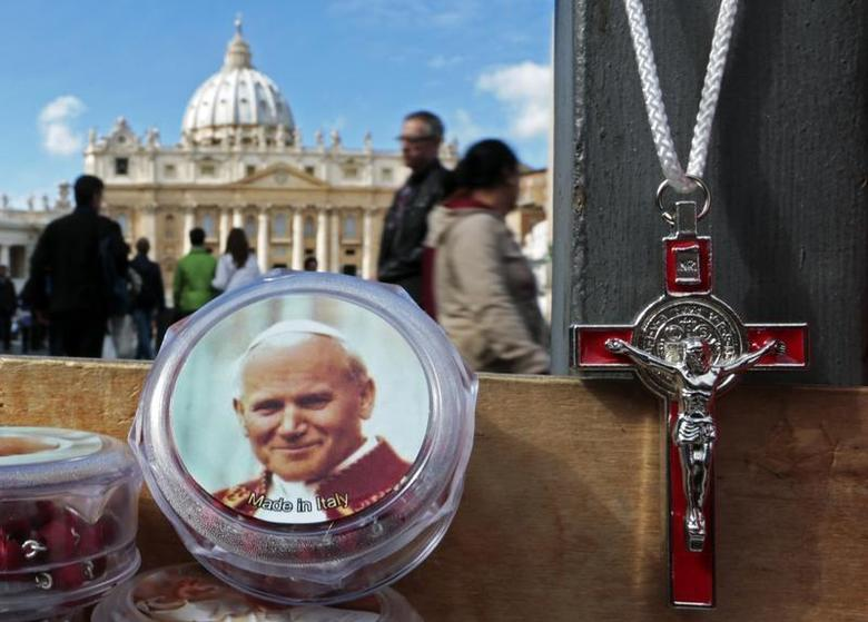 A picture of the late Pope John Paul II is seen on a rosary, for sale in Saint Peter's Square at the Vatican March 10, 2013. REUTERS/Eric Gaillard