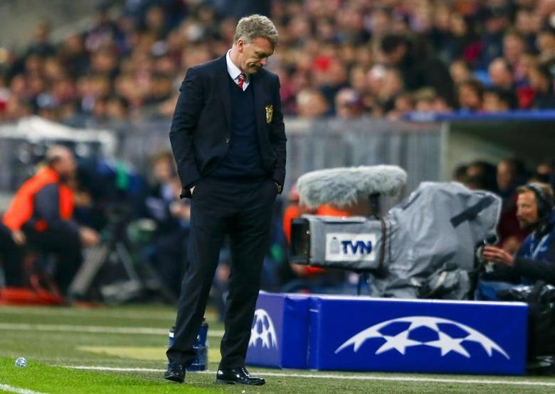Manchester United's manager David Moyes reacts after their Champions League quarter-final second leg soccer match against Bayern Munich in Munich, April 9, 2014. REUTERS/Michael Dalder