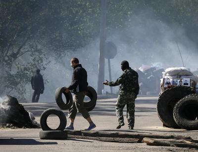 Russia says Kiev will face justice for 'bloody crime'...