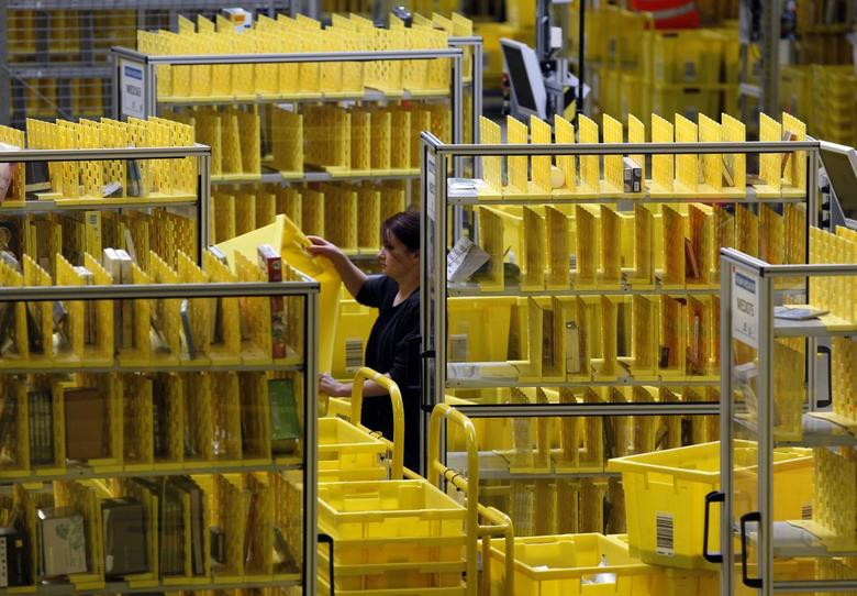 Worker collects items at Amazon's logistics centre in Graben near Augsburg December 16, 2013. REUTERS/Michaela Rehle