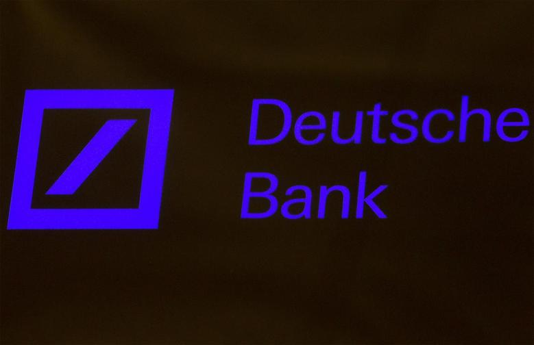 A Deutsche Bank sign is seen on the floor of the New York Stock Exchange January 15, 2014. REUTERS/Brendan McDermid