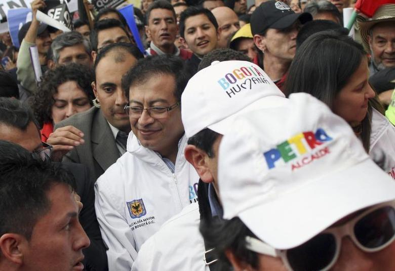 Bogota Mayor Gustavo Petro (3rd L) walks to Bolivar Square, after being restored as mayor by Colombian President Juan Manuel Santos, in Bogota April 23, 2014. REUTERS/Fredy Builes