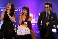 Bollywood Actress Priyanka Chopra (C) and Actress Sonakshi Sinha and Anil Kapoor (R) entertain the crowd ahead of the 15th International Indian Film Academy Awards in Tampa, Florida April 24, 2014. REUTERS/Mohammed Jaffer-SnapsIndia