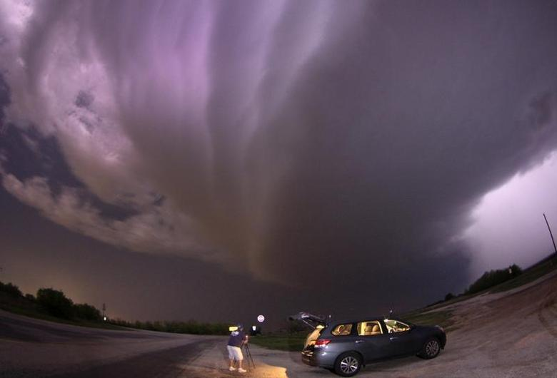 A large TVS (tornadic vortex signature) thunderstorm supercell passes over storm chaser Brad Mack in Graham, Texas late April 23, 2014. REUTERS/Gene Blevins