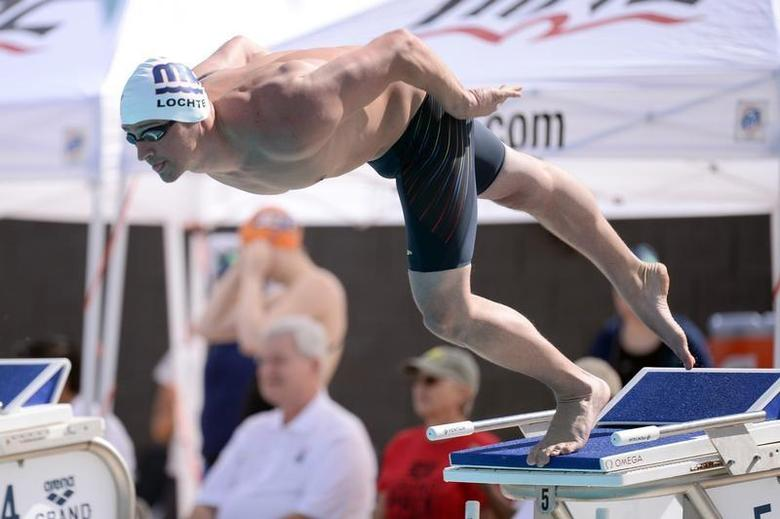 Apr 24, 2014; Mesa, AZ, USA; Ryan Lochte swims during the men's 100m freestyle event at Skyline Aquatic Center. Joe Camporeale-USA TODAY Sports