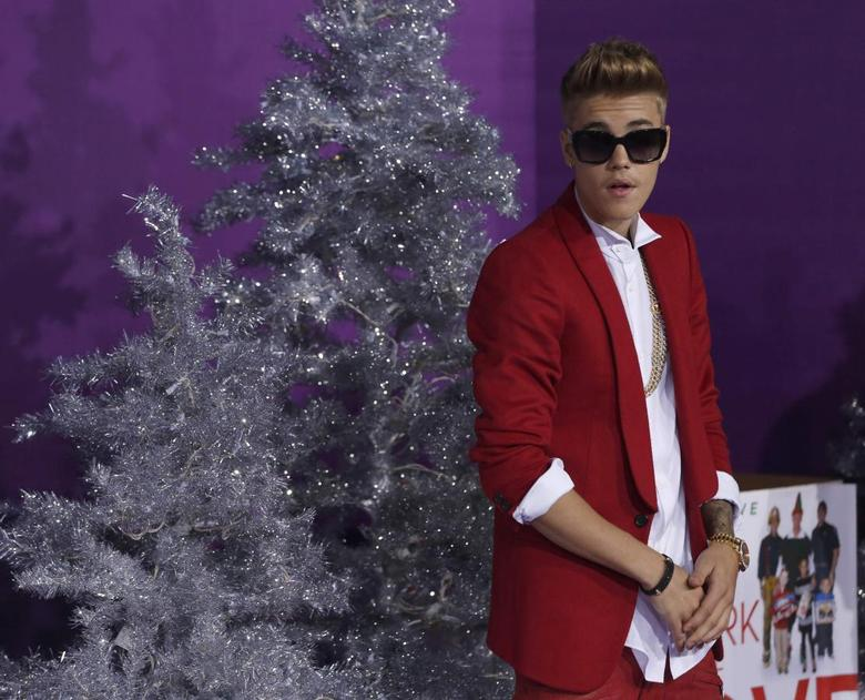 Singer Justin Bieber poses at the premiere of the documentary ''Justin Bieber's Believe'' in Los Angeles, California December 18, 2013. REUTERS/Mario Anzuoni