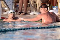 Apr 24, 2014; Mesa, AZ, USA; Michael Phelps and Ryan Lochte after the men's 100m butterfly race at the 2014 USA Swimming Grand Prix Series at Skyline Aquatic Center. Mandatory Credit: Joe Camporeale-USA TODAY Sports
