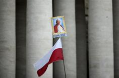 A John Paul II picture with Polish flag is seen in St. Peter's square at the Vatican, April 26, 2014. REUTERS/Alessandro Bianchi
