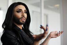 Austrian drag queen Conchita Wurst gestures during an interview with Reuters in Vienna April 24, 2014. REUTERS/Leonhard Foeger