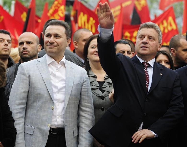Presidential candidate of ruling VMRO-DPMNE Gjorge Ivanov (R) greets his supporters next to Macedonian Prime Minister Nikola Gruevski during an election campaign rally in Veles April 25, 2014. REUTERS/Ognen Teofilovski