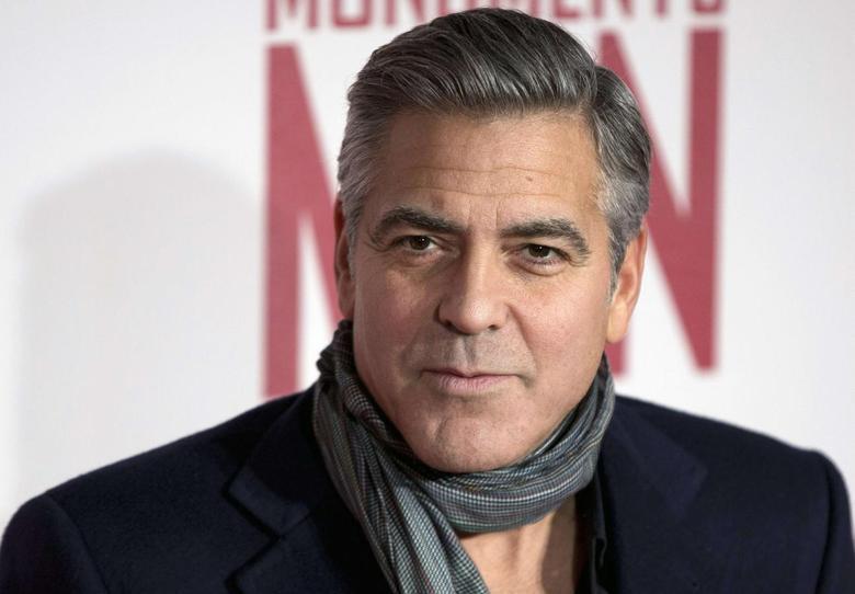 Actor and director George Clooney arrives for the UK premiere of his film ''The Monuments Men'' in London February 11, 2014. REUTERS/Neil Hall