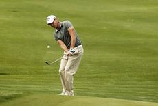 England's Danny Willett plays a shot on the ninth hole during the BMW Masters 2012 golf tournament at Lake Malaren Golf Club in Shanghai, October 26, 2012. REUTERS/Aly Song