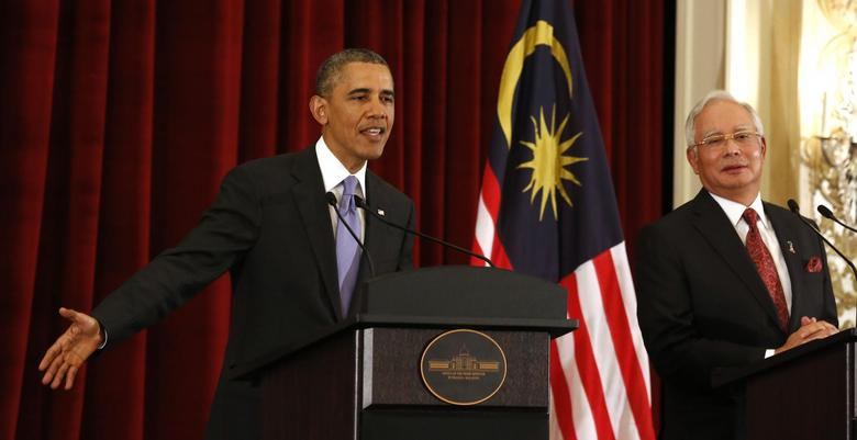 U.S. President Barack Obama talks next to Malaysian Prime Minister Najib Razak as they both participate in a news press conference at the Perdana Putra Building in Putrajaya, April 27, 2014. REUTERS/Larry Downing