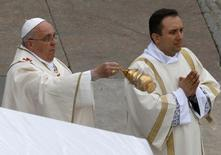 Pope Francis swings incense as he celebrates mass during the canonisation ceremony in St Peter's Square at the Vatican, April 27, 2014. REUTERS/Stefano Rellandini