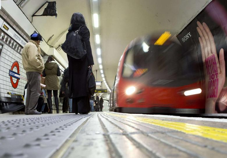 An underground train pulls into Leicester Square station in central London February 11, 2014. REUTERS/Neil Hall