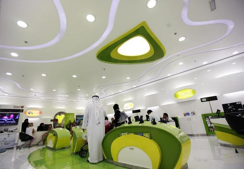 Customers wait inside an Etisalat store at a shopping mall in Dubai, July 10, 2012. REUTERS/Jumana El Heloueh