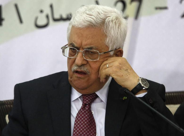 Palestinian President Mahmoud Abbas attends a meeting with the Palestinian Liberation Organization's (PLO) central council in the West Bank City of Ramallah April 26, 2014. REUTERS/Mohamad Torokman