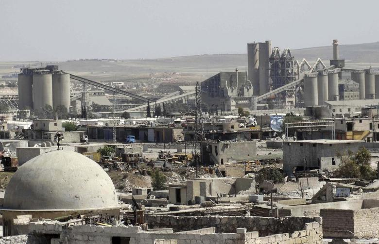 A general view shows a cement factory that activists said is controlled by forces loyal to Syria's president Bashar Al-Assad in Ramouse, Aleppo April 26, 2014. Picture taken April 26, 2014. REUTERS/Stringer