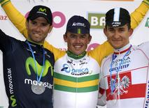 Orica-GreenEdge rider Simon Gerrans of Australia (C) celebrates on the podium after winning the Liege-Bastogne-Liege Classic cycling race, flanked by second-placed Movistar team rider Alejandro Valverde of Spain (L) and third-placed Omega Pharma-Quick Step rider Michal Kwiatkowski of Poland (R) in Ans, near Liege April 27, 2014. REUTERS/Laurent Dubrule
