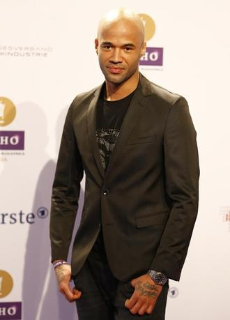 Singer Mr. Probz arrives on the red carpet for the Echo Music Awards ceremony in Berlin March 27, 2014. REUTERS/Kai Pfaffenbach