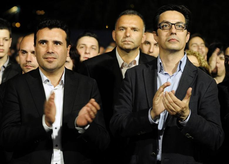 Leader of the Macedonian opposition party SDSM's leader Zoran Zaev (L) and presidential candidate Stevo Pendarovski greets their supporters during an election campaign rally in Veles April 24, 2014. REUTERS/Ognen Teofilovski