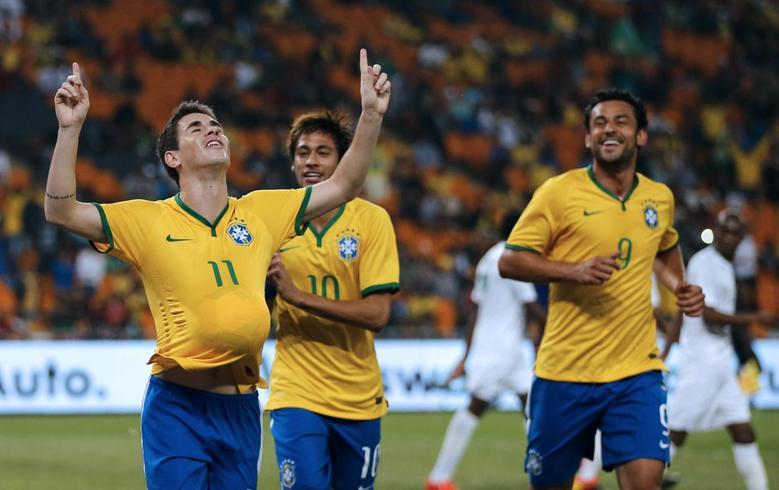 Brazil's Oscar (L) celebrates his goal against South Africa with his team mates Neymar (C) and Fred during their international friendly soccer match at the First National Bank (FNB) Stadium, also known as Soccer City, in Johannesburg March 5, 2014. REUTERS/Siphiwe Sibeko