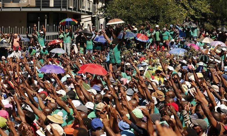 Striking miners gather outside Lonmin's headquarters in Johannesburg, April 3, 2014. REUTERS/Siphiwe Sibeko
