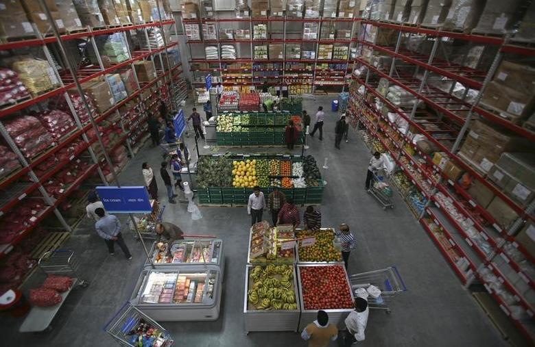 Customers shop at a Best Price Modern Wholesale store, a joint venture of Wal-Mart Stores Inc and Bharti Enterprises, in Jammu November 26, 2011. REUTERS/Mukesh Gupta