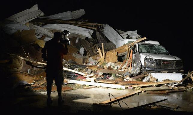 First In Video news video photographer Brad Mack covers the damage seen after a tornado hit the town of Mayflower, Arkansas around 7:30 pm CST, late April 27, 2014.  REUTERS/Gene Blevins
