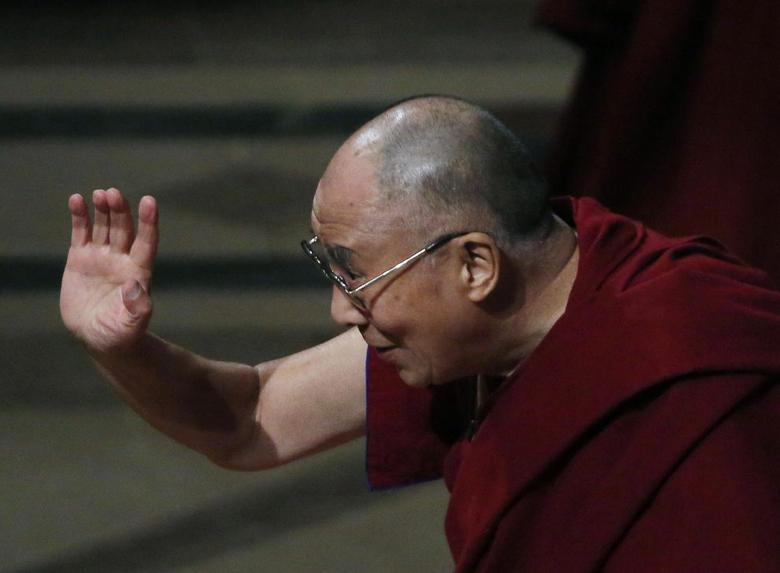His Holiness the Dalai Lama waves good bye after his speech and at the National Cathedral in Washington March 7, 2014. REUTERS/Gary Cameron