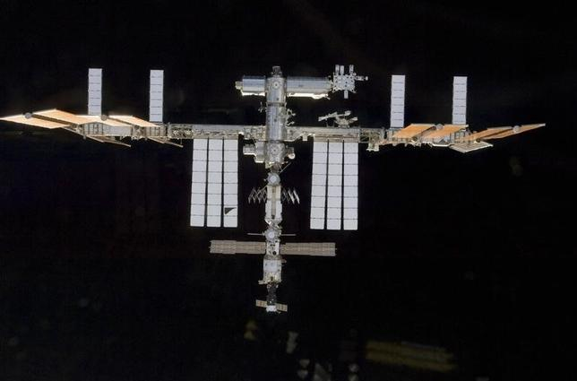 Backdropped by the blackness of space, the International Space Station is seen in this image taken by a crew member aboard the Space Shuttle Atlantis during rendezvous and docking activities in this photo released by NASA and taken November 18, 2009.       REUTERS/NASA Handout