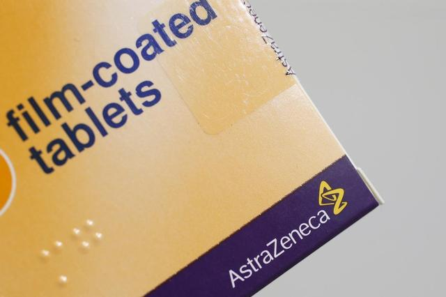 The logo of AstraZeneca is seen on a medication package in a pharmacy in London April 28, 2014. REUTERS/Stefan Wermuth