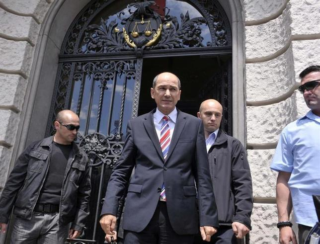 Former Slovenian Prime Minister Janez Jansa (2nd L) reacts as he steps out of the court after his corruption trial involving Finnish company Patria in Ljubljana June 5, 2013. REUTERS/Srdjan Zivulovic