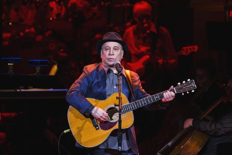 Singer Paul Simon performs during the Rainforest Fund's 25th anniversary benefit concert in New York April 17, 2014.  REUTERS/Lucas Jackson