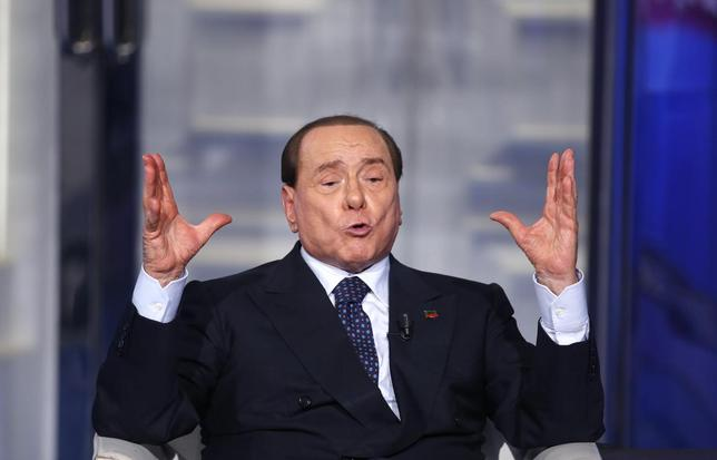 Italy's former Prime Minister Silvio Berlusconi gestures as he appears as a guest on the RAI television show Porta a Porta (Door to Door) in Rome, April 24, 2014. REUTERS/Remo Casilli