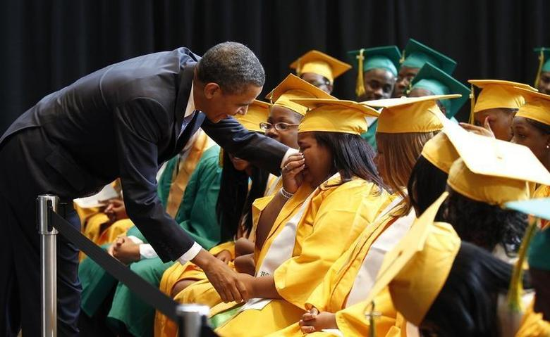 U.S. President Barack Obama comforts a student overcome with emotion after speaking with the graduating class from Booker T. Washington High School in Memphis, Tennessee on their commencement day May 16, 2011. REUTERS/Kevin Lamarque