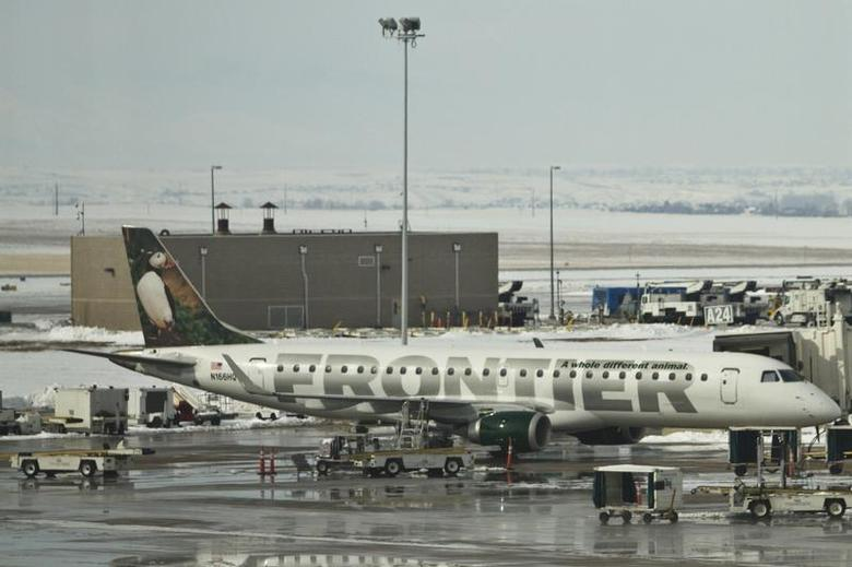 A Frontier Airlines jet waits at the gate prior to departure at the Denver International Airport in Denver, Colorado, February 4, 2012. REUTERS/Nathan Armes