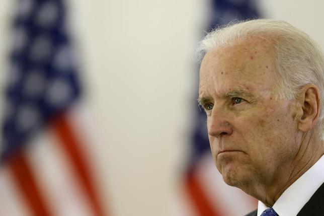 U.S. Vice President Joe Biden listens during a news conference in Vilnius March 19, 2014. REUTERS/Ints Kalnins