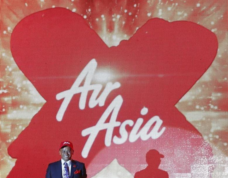 Azran Osman-Rani, chief executive officer of long-haul carrier AirAsia X, smiles during the launch of the company's prospectus in Kuala Lumpur June 10, 2013. AirAsia X, founded by entrepreneur Tony Fernandes, launched on Monday an up to $370 million initial public offering in Malaysia, seeking to raise funds to repay bank loans and for capital expenditures, according to a term sheet of the deal seen by Reuters. REUTERS/Bazuki Muhammad (MALAYSIA - Tags: TRANSPORT BUSINESS TRAVEL) - RTX10IB9
