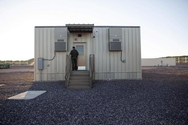 A border patrol agent opens the entrance to a temporary holding facility at the U.S. Department of Homeland Security's Forward Operating Base (FOB) Hedglen located southeast of Douglas, Arizona August 8, 2013. REUTERS/Samantha Sais