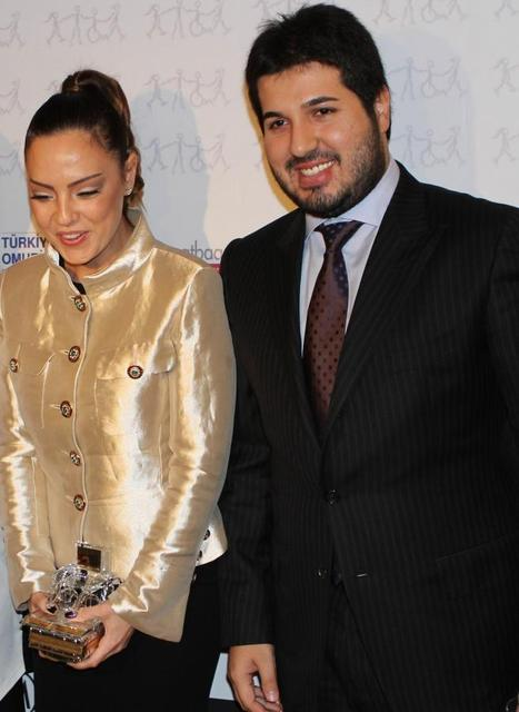 Turkish singer Ebru Gundes is seen with her husband, businessman Reza Zarrab (R), in Istanbul in this February 27, 2013 file photo. REUTERS/Hurriyet Daily/Handout