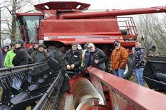 Farmers check out used equipment during a farm auction near Fannystelle, Manitoba, April 24, 2014.REUTERS/Fred Greenslade