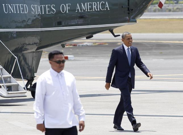 U.S. President Barack Obama walks towards to Air Force One during his departure at Manila international airport April 29, 2014. REUTERS/Romeo Ranoco